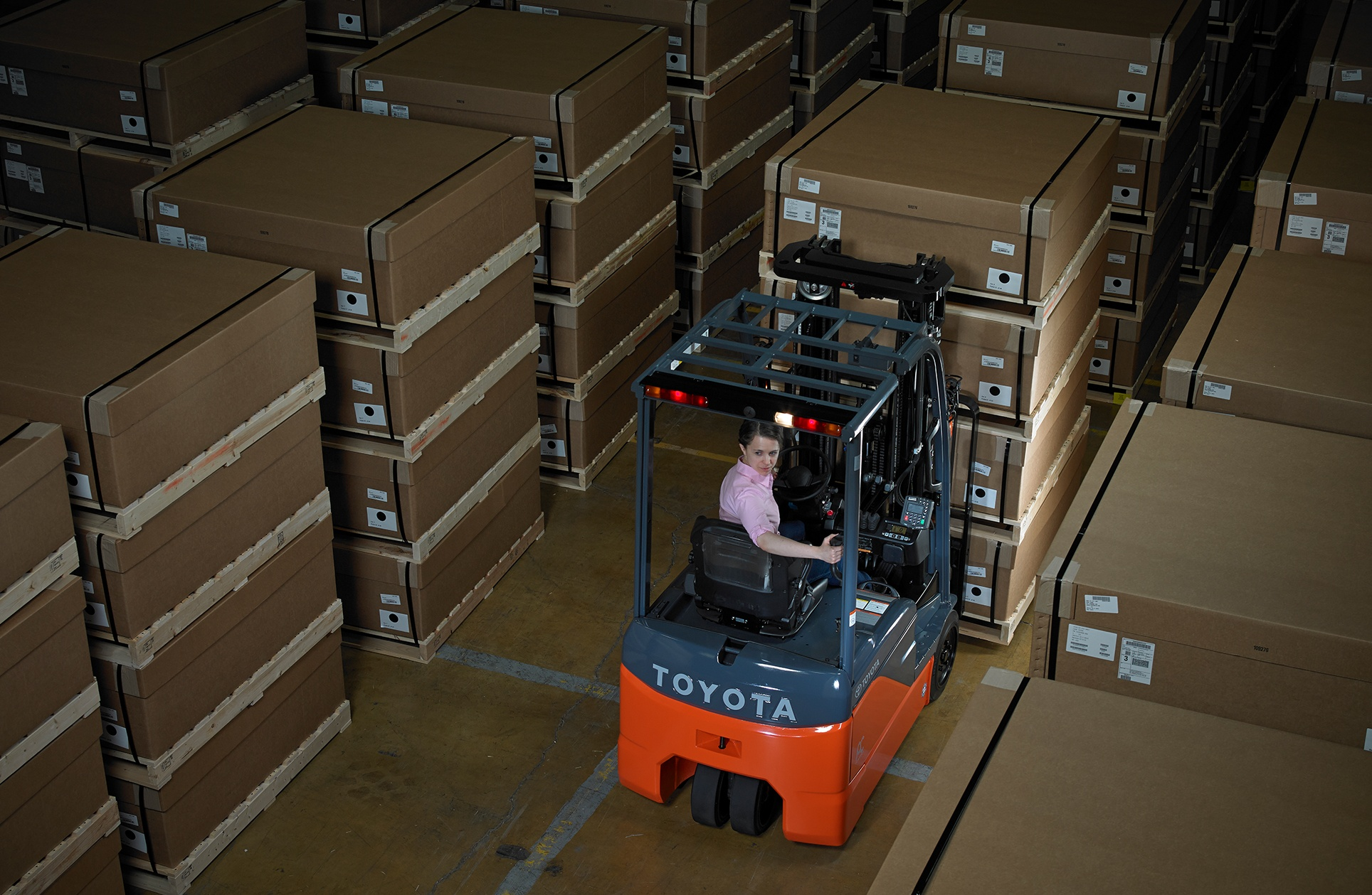 Toyota 3-Wheel Electric Forklift being used in warehouse